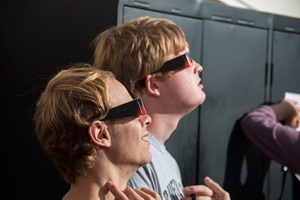These two men use special sun glasses to look at the sun without damaging their eyes. Photo: Travis Bildahl