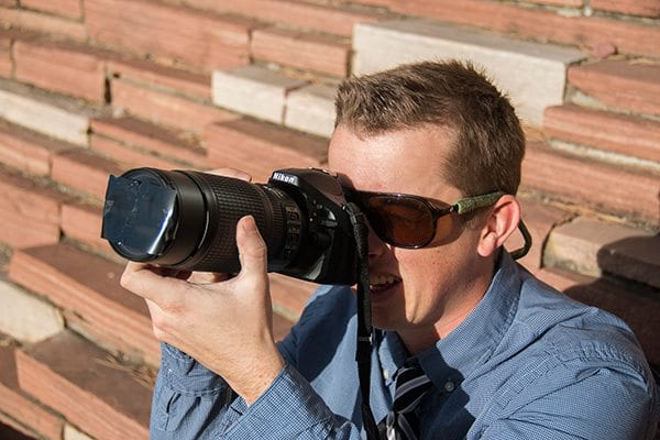 CU Boulder student getting a shot of the eclipse by using a DIY filter to protect his camera. Photo: Travis Bildahl