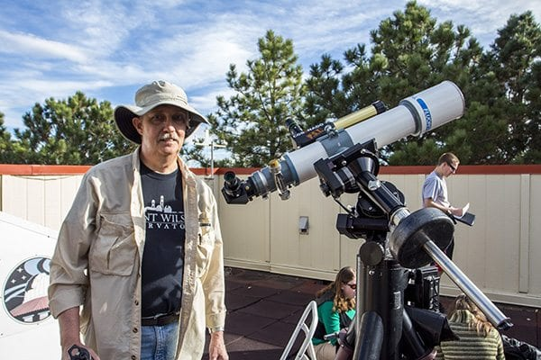 Wayne from the Boulder Astronomy and Space Society checks out the eclipse through his telescope. (Photo: Joseph Wirth)