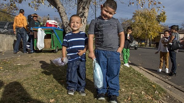 Two brothers get snacks after Sunday Mass in North Boulder. (Photo: Joseph Wirth)