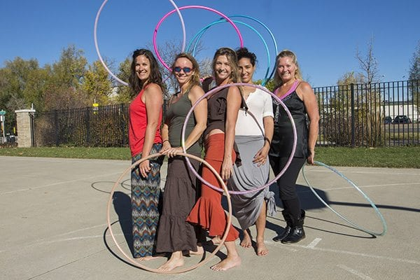A hoola hoop dance group called O Dance practices in Green Leaf Park off of Folsom. (Photo: Joseph Wirth)