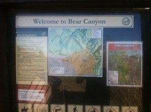 Trailhead entrance sign and map