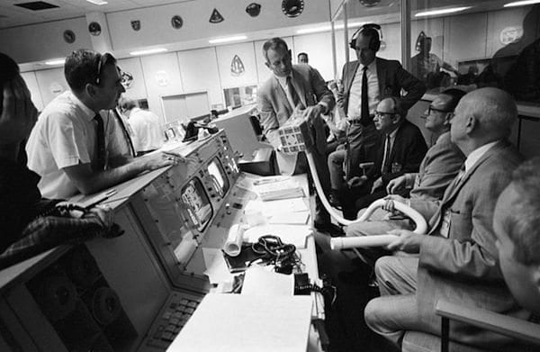 Photo Credit: NASA. Mission Control during the Apollo 13 incident, trying to rig an O2 scrubber