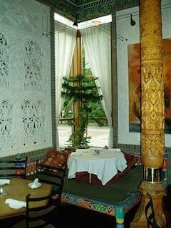Photo Credit: Oreo Priest. A low table in Dushanbe Teahouse. Hand-carved cedar column seen on the right.
