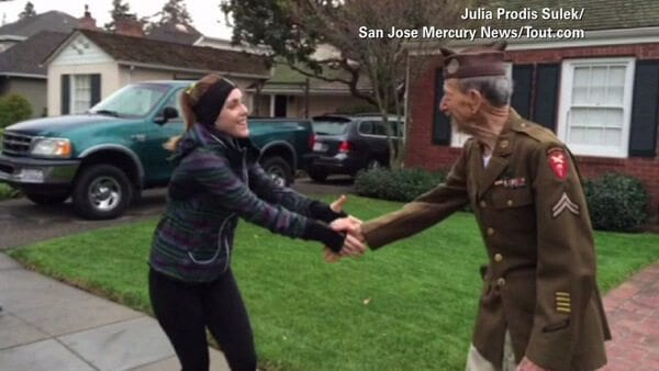 runner shakes hands with veteran