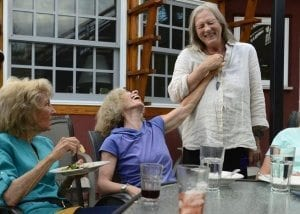 BOULDER, CO - SEPTEMBER 2: Margaret Porter laughs with Clyde Rae Jolie-Ashe after the end of dinner September 2, 2015 at Silver Sage Village. The active adult cohousing community for those 55 or older is setup like a usual condo community with every person having their own place, but the sense of community is what is unique. (Photo By Brent Lewis/The Denver Post)