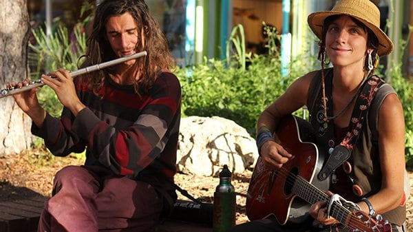 A couple jams out together on Pearl on a sunny afternoon in Boulder.