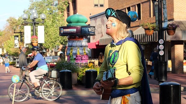 EARTH MAN can be found all over Boulder, but here you can see he's playing in the heart of Pearl Street.