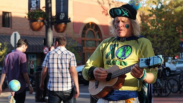 EARTH MAN jams out on the Mall singing songs that promote the planet.