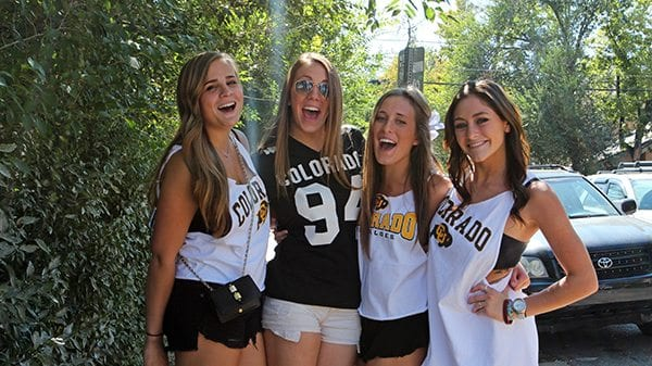 A group of CU student Buffs roam the hill in search of a pre-game party. (Photo Credit Joseph Wirth)
