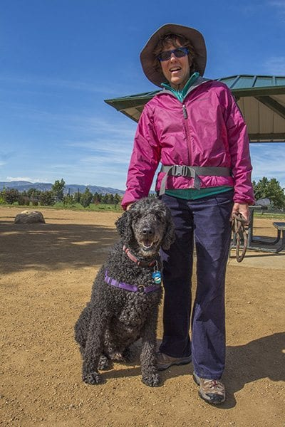 Mary Ann Wilner and her poodle Kofi hang out at the East boulder Community Center on a bluebird afternoon. (Photo: Joseph Wirth)