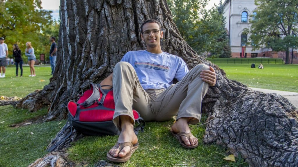 Senior Chemical Engineering major Aziz Alobaid from Kuwait hanging out a famous tree seat in Norlin Quad. He told me had never been to the U.S. before he came to CU and only saw pictures of the campus online before applying. (Photo: Joseph Wirth)