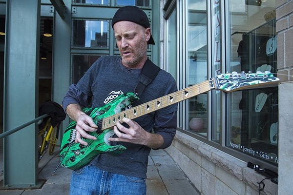 Local guitarist jams out on Pearl Street with the instrumentals to Carlos Santana's Black Magic Woman. (Photo: Joseph Wirth)