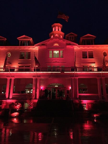 The Stanley Hotel bathed in red light during the horror film fest.