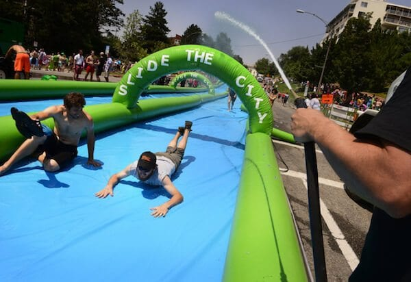 Scott Sommerdorf   |  The Salt Lake Tribune Slide The City hosted a 1,000 foot slip-n-slide in downtown Salt Lake City, Saturday, July 19, 2014.