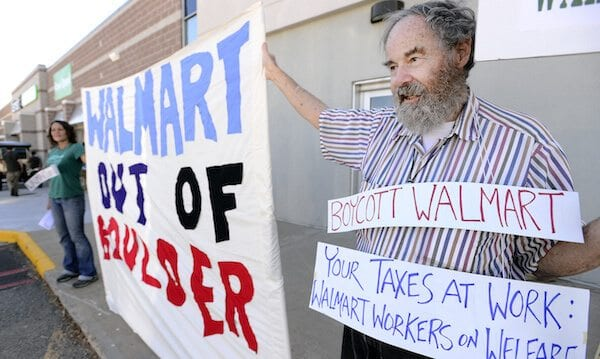 John Russell protests at the Walmart grand opening in Boulder during the store's grand opening on Wednesday, Oct 2, 2013.  Paul Aiken / Camera