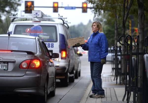 Photo Credit: Jeremy Papasso--Daily Camera. Renee McLaughin peacefully seeks financial assistance in Boulder