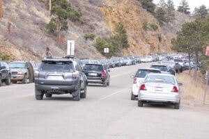 Traffic and parked cars on Canyon Blvd in Nederland